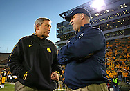 October 20 2012: Iowa Hawkeyes head coach Kirk Ferentz and Penn State Nittany Lions head coach Bill O'Brien talk before the start of the NCAA football game between the Penn State Nittany Lions and the Iowa Hawkeyes at Kinnick Stadium in Iowa City, Iowa on Saturday October 20, 2012. Penn State defeated Iowa 38-14.