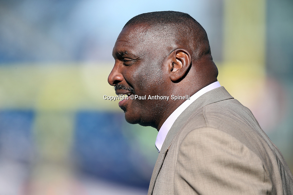 Former Washington Redskins quarterback Doug Williams chats on the sideline during pregame warmups before the 2015 week 9 regular season NFL football game against the New England Patriots on Sunday, Nov. 8, 2015 in Foxborough, Mass. The Patriots won the game 27-10. (©Paul Anthony Spinelli)