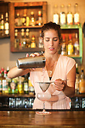 BROOKLYN, NY - July 28, 2015: Mixologist Ivy Mix pouring cocktails at Legend on Smith Street in Carroll Gardens.<br /> <br /> CREDIT: Clay Williams for Latina Magazine.<br /> <br /> © Clay Williams / claywilliamsphoto.com
