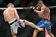 "STOCKHOLM, SWEDEN, APRIL 14:  Jason Young (blue shorts) vs Eric Wisely (white trunks) during ""UFC on Fuel TV: Gustafsson vs. Silva"" inside the Ericsson Globe Arena in Stockholm, Sweden"