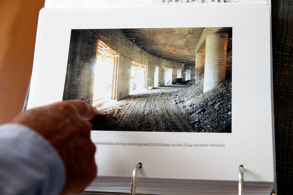 Joseph Horacek shows documents with pictures taken by Hadid and posted on his website inside the mansion of Mohamed Hadid under construction at 901 Strada Vecchia on in the Bel Air neighborhood of Thursday, July 16, 2015 in Los Angeles, California. Photo by Patrick T. Fallon for DailyMail.com