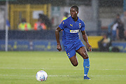 AFC Wimbledon defender Paul Osew (37) dribbling in the rain during the Pre-Season Friendly match between AFC Wimbledon and Crystal Palace at the Cherry Red Records Stadium, Kingston, England on 30 July 2019.