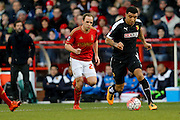 Watford forward Troy Deeney gets away from Nottingham Forest midfielder David Vaughan  during the The FA Cup fourth round match between Nottingham Forest and Watford at the City Ground, Nottingham, England on 30 January 2016. Photo by Simon Davies.