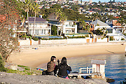 Tourists admire the views at Camp Cove Beach, Sydney, Australia.