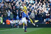 Leeds United defender Pontus Jansson (18)  and Birmingham City forward Lukas Jutkiewicz  contest an aerial ball  during the EFL Sky Bet Championship match between Birmingham City and Leeds United at St Andrews, Birmingham, England on 6 April 2019.