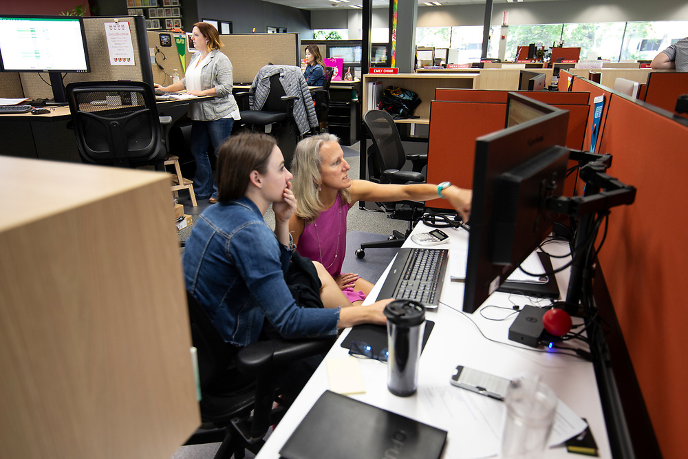 Opus Agency is a winner in The Oregonian/OregonLive's 2018 Top Workplaces competition. Hannah Carbonaro (left), Account Coordinator, talks with Erin Johansen, Financial Analyst, in the brand events and marketing agency's Beaverton location at 9000 S.W. Nimbus Avenue. Photo by Randy L. Rasmussen