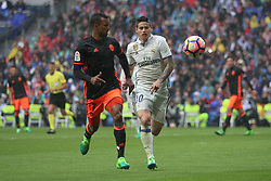 April 29, 2017 - Madrid, Spain - MADRID, SPAIN. APRIL 29th, 2017 - James Rodriguez and James chasing the ball. La Liga Santander matchday 35 game. Real Madrid defeated 2-1 Valencia with goals scored by Cristiano Ronaldo (26th minute) and Marcelo (86th minute). Parejo (82nd minute) scored for Valencia. Santiago Bernabeu Stadium. Photo by Antonio Pozo | PHOTO MEDIA EXPRESS (Credit Image: © Antonio Pozo/VW Pics via ZUMA Wire/ZUMAPRESS.com)
