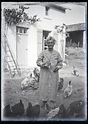 farm woman feeding the chickens France circa 1930s