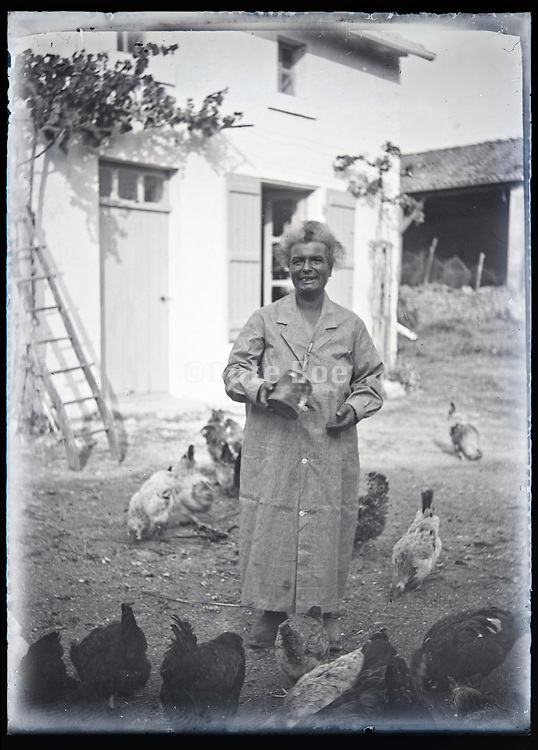 farm woman feeding the chickens France circa 1930s