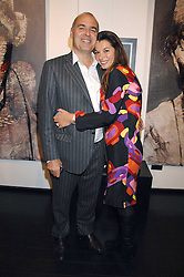 GILLES DYAN and his wife FLORENCE he is chairman of the Opera Gallery at a private view of paintings by Lita Cabellut and Russian artist Yuri Kuper at Opera Gallery, 134 New Bond Street, London on 2nd April 2008.<br />