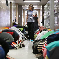 Adam Robison | BUY AT PHOTOS.DJOURNAL.COM<br /> Jennifer Tharp, Pre-Algebra teacher at Mooreville Middle School, walks the eighth grade hall checking on students during a tornado drill Wednesday morning in Mooreville.