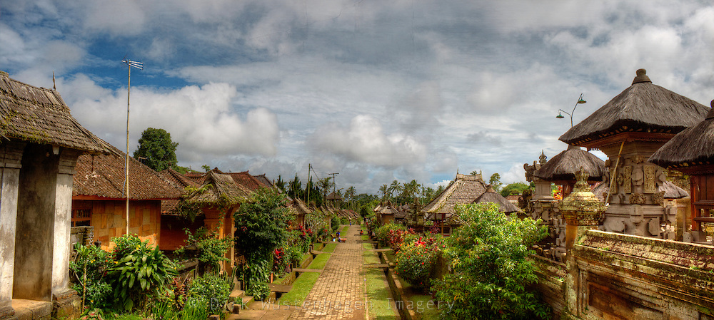 View down a street of a traditional village on the island of bali, Indonesia.