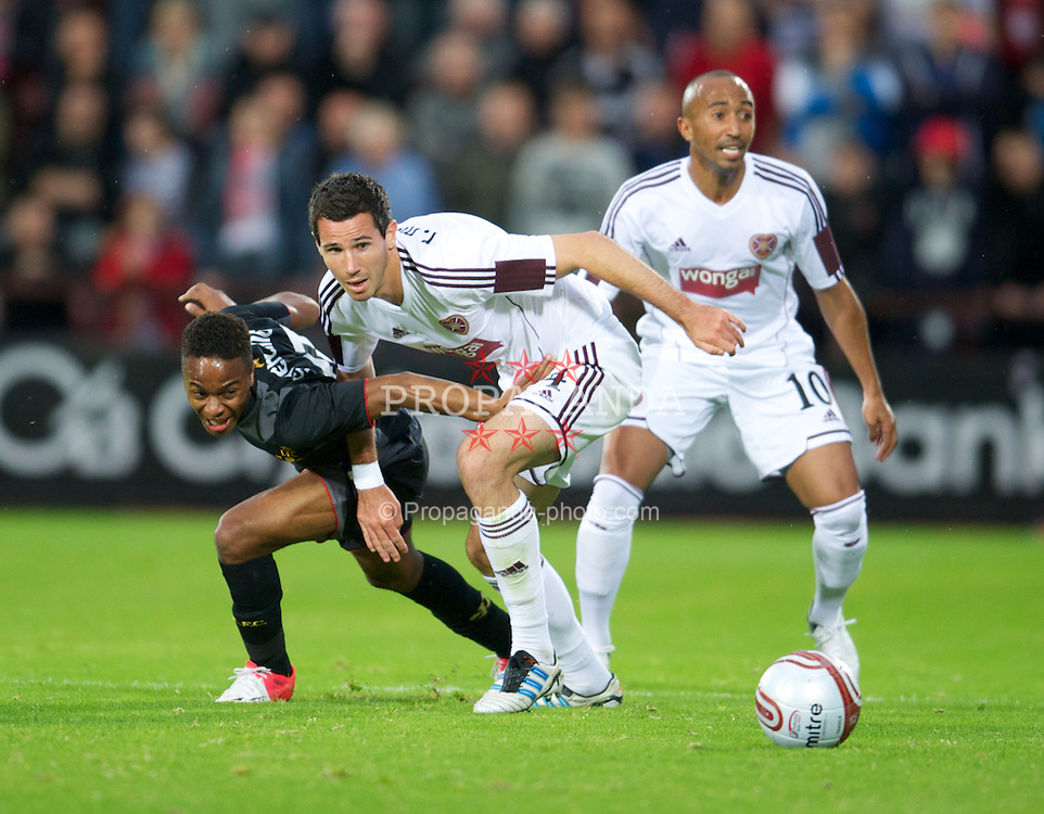 EDINBURGH, SCOTLAND - Thursday, August 23, 2012: Liverpool's Raheem Sterling in action against Heart of Midlothian's Ryan McGowan during the UEFA Europa League Play-Off Round 1st Leg match at Tynecastle. (Pic by David Rawcliffe/Propaganda)