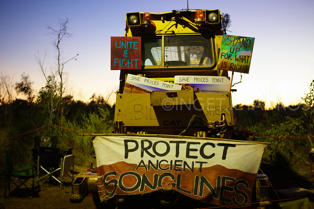 A truck decorated by banners, blocking the path to Woodside's compound,  at Manari Rd. Broome, WA