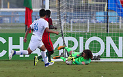 Team USA goalkeeper Edgar Alguera Mercado (12) makes a save on a shot from Portugal forward Herculano Nabian (9) during a CONCACAF boys under-15 championship soccer game, Saturday, August 10, 2019, in Bradenton, Fla. Portugal defeated Team USA 3-0 and advanced to the finals against Slovenia. (Kim Hukari/Image of Sport)