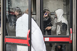 © Licensed to London News Pictures . 06/04/2017 . Manchester , UK . Four people huddle in to two telephone boxes and consume rolled cigarettes , believed to contain spice . An epidemic of abuse of the drug spice by some of Manchester's homeless population , in plain sight , is causing users to experience psychosis and a zombie-like state and is daily being witnessed in the Piccadilly Gardens area of Manchester , drawing large resource from paramedic services in the city centre . Photo credit : Joel Goodman/LNP