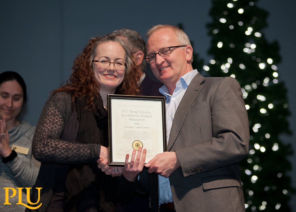 Allan Belton present an award to Jennifer Jenkins at the PLU Christmas Brunch, Thursday, Dec. 14, 2017. (Photo: John Froschauer/PLU)