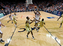 Virginia guard Jeff Jones (1) shoots over Georgia Tech guard Lewis Clinch (0).  The Virginia Cavaliers men's basketball team fell to the Georgia Tech Yellow Jackets 92-82 in overtime at the John Paul Jones Arena in Charlottesville, VA on January 27, 2008.