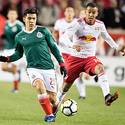 HARRISON, NEW JERSEY- APRIL 10:  Michael Perez #25 of C.D. Guadalajara challenged by Alejandro Romero Gamarra #10 of New York Red Bulls during the New York Red Bulls Vs C.D. Guadalajara CONCACAF Champions League Semi-final 2nd leg match at Red Bull Arena on April 10, 2018 in Harrison, New Jersey. (Photo by Tim Clayton/Corbis via Getty Images)