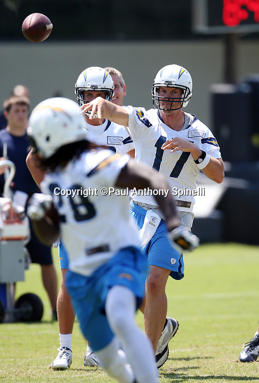 San Diego Chargers quarterback Philip Rivers (17) throws a pass to San Diego Chargers rookie running back Melvin Gordon (28) on a pass play during the San Diego Chargers Spring 2015 NFL minicamp practice on Wednesday, June 17, 2015 in San Diego. (©Paul Anthony Spinelli)