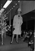 09/03/1964<br /> 03/09/1964<br /> 09 March 1964<br /> McBirney's Fashion show at McBirney's, Aston Quay, Dublin. Image shows model Blanche wearing a check coat.