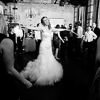 Erin spins on the dance floor at her wedding reception at the Green Building in Brooklyn, New York.