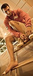 07.06.2011, Stanglwirt, Going, AUT, Wladimir Klitschko, Training, im Bild Wladimir Klitschko bindet sich die Schuhe, Bild wurde farblich verändert. EXPA Pictures © 2010, PhotoCredit: EXPA/ J. Groder