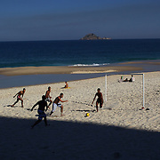 Locals play beach football during the late afternoon sunshine at Sao Conrado beach, Rio de Janeiro,  Brazil. 8th July 2010. Photo Tim Clayton..
