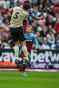 Harry Maguire (Man United) & Sebastien Haller (West Ham) during the Premier League match between West Ham United and Manchester United at the London Stadium, London, England on 22 September 2019.
