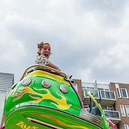 Nederland, Tilburg, 20160726<br /> De Octopus draait snel rond met felle kleuren.Kermis in Tilburg. De grootste kermis van Nederland en de Benelux.Op het kilometers lange parcours staan tientallen attracties Netherlands, TilburgFunfair in Tilburg. The largest fair in the Netherlands and Benelux.dozens of attractions on the kilometer-long trail
