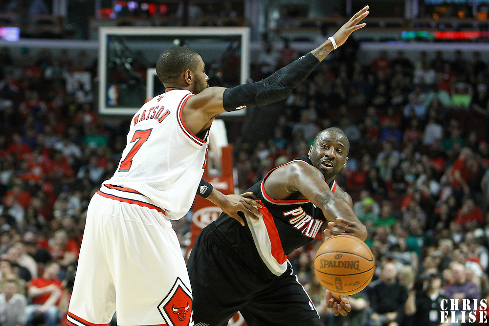 16 March 2012: Portland Trail Blazers point guard Raymond Felton (5) passes the ball past Chicago Bulls point guard C.J. Watson (7) during the Portland Trail Blazers 100-89 victory over the Chicago Bulls at the United Center, Chicago, Illinois, USA.