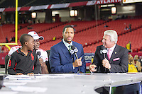 20 January 2013: Frank Gore of the San Francisco 49ers and his son talk to Michael Strahan and Jimmy Johnson after defeating the Atlanta Falcons 28-24 in the NFC Championship Game at the Georgia Dome in Atlanta, GA to go to Superbowl XLVII.