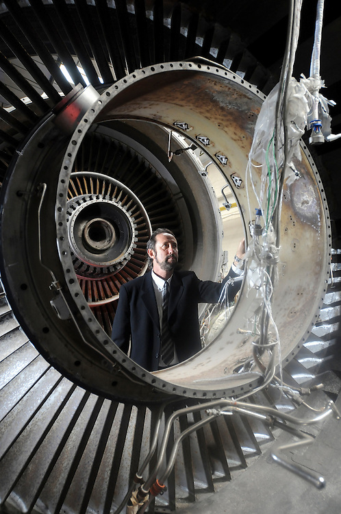 Pictured inspecting a used jet engine, ready to be recycled, is Sandy Shadrow - executive president of SOS Metals, Inc.