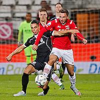 ALKMAAR - 26-09-2015, AZ - Heracles Almelo, AFAS Stadion, 3-1, AZ speler Muamer Tankovic (r), Heracles Almelo speler Joey Pelupessy (l).