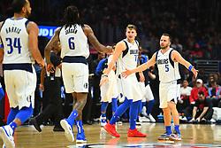 December 21, 2018 - Los Angeles, CA, U.S. - LOS ANGELES, CA - DECEMBER 20: Dallas Mavericks Guard J.J. Barea (5), Dallas Mavericks Guard Luka Doncic (77) celebrate a Dallas Mavericks Center DeAndre Jordan (6) dunk during a NBA game between the Dallas Mavericks and the Los Angeles Clippers on December 20, 2018 at STAPLES Center in Los Angeles, CA. (Photo by Brian Rothmuller/Icon Sportswire) (Credit Image: © Brian Rothmuller/Icon SMI via ZUMA Press)