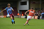 Henry Cameron n  shoots towards the goal during the Sky Bet League 1 match between Scunthorpe United and Blackpool at Glanford Park, Scunthorpe, England on 5 September 2015. Photo by Ian Lyall.