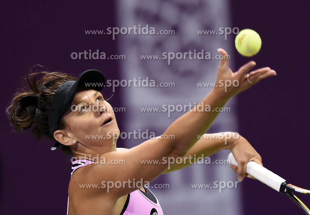 Casey Dellacqua of Australia serves during the first round match against Venus Williams of the United States in the WTA Qatar Open tennis tournament in Doha, Qatar, Feb. 23, 2015. Casey Dellacqua lost 1-2. EXPA Pictures &copy; 2015, PhotoCredit: EXPA/ Photoshot/ Chen Shaojin<br /> <br /> *****ATTENTION - for AUT, SLO, CRO, SRB, BIH, MAZ only*****