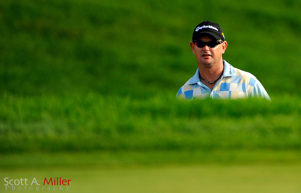 Aug 13, 2009; Chaska, MN, USA; Rory Sabbatini (RSA) lines up his shot from a greenside bunker on the 11th hole during the first round of the 2009 PGA Championship at Hazeltine National Golf Club.  ©2009 Scott A. Miller