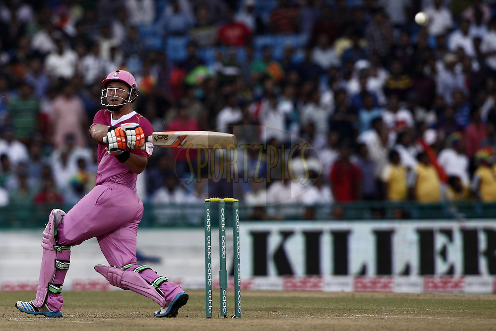 BJ Watling of the NORTHERN KNIGHTS hit the shot during the qualifier 3 match of the Oppo Champions League Twenty20 between the Northern Knights and the Lahore Lions held at the Chhattisgarh International Cricket Stadium, Raipur, India on the 14th September 2014<br /> <br /> Photo by:  Deepak Malik / Sportzpics/ CLT20<br /> <br /> <br /> Image use is subject to the terms and conditions as laid out by the BCCI/ CLT20.  The terms and conditions can be downloaded here:<br /> <br /> http://sportzpics.photoshelter.com/gallery/CLT20-Image-Terms-and-Conditions-2014/G0000IfNJn535VPU/C0000QhhKadWcjYs