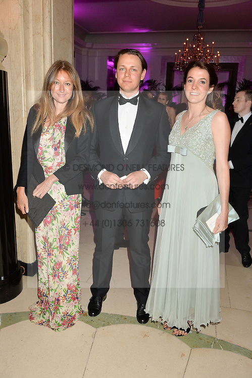 Left to right, ANNA MATTHEWS, HANNS KENDEL and PRINCESS TESSY OF LUXEMBOURG at the QBF Spring Gala in aid of the Red Cross War Memorial Children's Hospital hosted by Heather Kerzner and Jeanette Calliva at Claridge's, Brook Street, London on 12th May 2015.