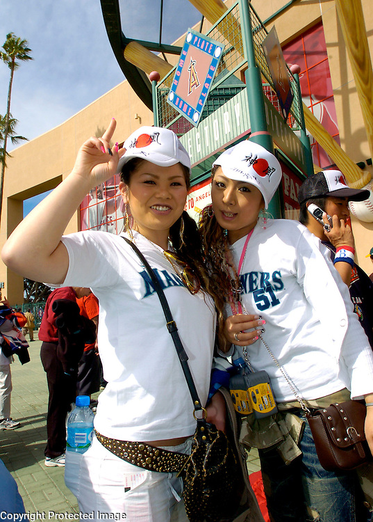 Team Japan fans Nao Kawae (L) and Yuka Miyashita (R) from Japan arrive before the start of Round 2 action matching Team Mexico and Team Japan at Angel Stadium of Anaheim.