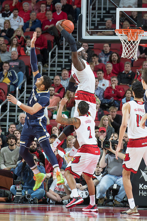 Louisville forward Montrezl Harrell, center, grabs a rebound in the first half. <br /> <br /> The University of Louisville hosted the Notre Dame, Wednesday, March 04, 2015 at Yum Center in Louisville. <br /> <br /> Photo by Jonathan Palmer