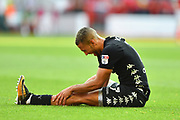 Leeds United forward Kemar Roofe (7) suffering from cramp during the EFL Sky Bet Championship match between Nottingham Forest and Leeds United at the City Ground, Nottingham, England on 26 August 2017. Photo by Jon Hobley.