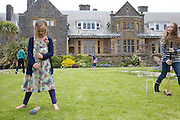 Playing croquet in the garden at Pickwell Manor. From left to right: Zac Baker (11), Milly-grace (8), Liza Baker (9), Molly Elliott (10). Pickwell Manor, Georgeham, North Devon, UK.<br /> CREDIT: Vanessa Berberian for The Wall Street Journal<br /> HOUSESHARE