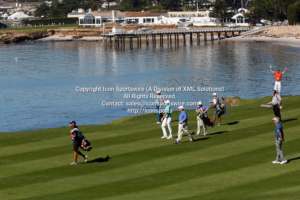 Feb 15 2015: Nick Watney (center top) signals his fairway shot went way right off of Hole 6 during the final round of the AT&T Pebble Beach National Pro-Am in Pebble Beach, CA.