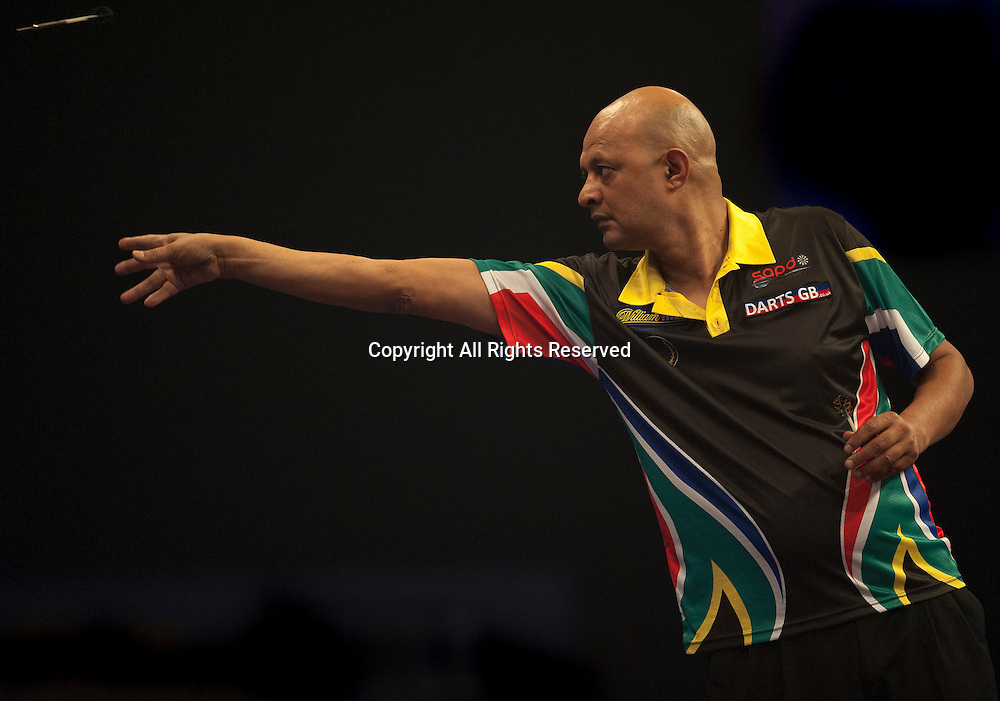 22.12.2014.  London, England.  William Hill PDC World Darts Championship.  Nolan Arendse [RSA] in action during his game with Brendan Dolan (11) [NIR].