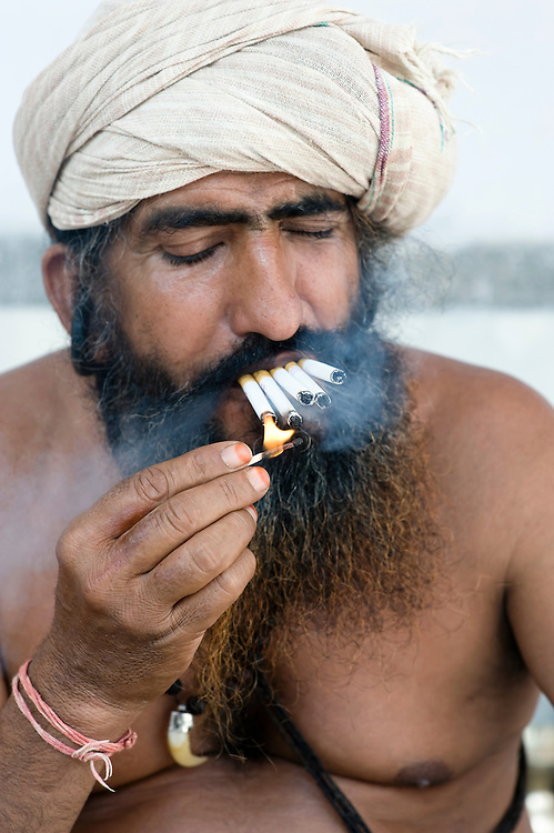 This saddhu in Pushkar (Rajasthan, India) was very proud he could smoke upto 15 cigarettes at the samen time. He was unaware of any health risks and coughed badly.