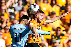 Matt Doherty of Wolverhampton Wanderers challenges Dwight McNeil of Burnley - Mandatory by-line: Robbie Stephenson/JMP - 25/08/2019 - FOOTBALL - Molineux - Wolverhampton, England - Wolverhampton Wanderers v Burnley - Premier League