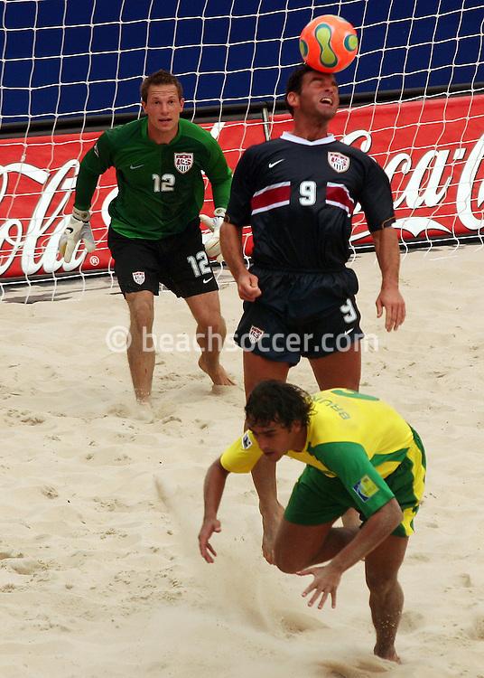 Football - FIFA Beach Soccer World Cup 2006 - Group A - BRA X USA - Rio de Janeiro - Brazil 07/11/2006<br /> Zak Ibsen jumps for the next to Bruno - Brazil -during the match   Event Title Board Mandatory Credit: FIFA / Ricardo Moraes