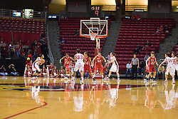 20 November 2010: Kenyatta Shelton looks over the Cougar defense during an NCAA Womens basketball game between the Southern Illinois-Edwardsville Cougars and the Illinois State Redbirds at Redbird Arena in Normal Illinois.